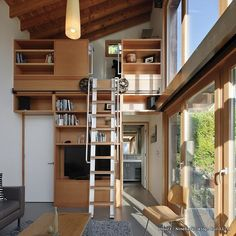 The Garden Pavilion is a detached accessory dwelling unit off a main house located in Seattle. The 37sqm structure holds many functions for the family: part office space music room for their kids and guest suite for extended family. Large vertical windows provide ample views to the outdoors.