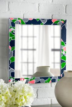 Easy DIY fabric covered mirror adds a pop of color to any room.