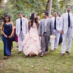 Brides: Nitya & Neal in Atlanta, GA. Neal wore a Hugo Boss suit and Burberry tie, while his seven groomsmen sported seersucker suits and ties from Jos. A. Bank. Nitya's bridesmaids wore blue Priscilla of Boston dresses in various styles the bride chose for them.
