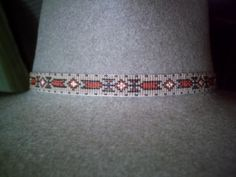EARTHTONE GEOMETRIC BEADED HAT BAND     NATIVE AMERICAN STYLE BEADED HATBAND             All my beaded hatbands are individually hand beaded on my handmade oak loom or in peyote, by myself personally,