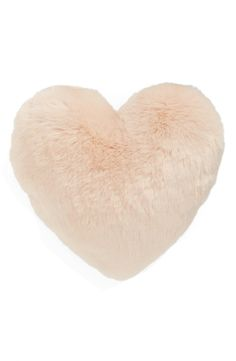 This plush, heart-shaped accent pillow in remarkably soft pink faux fur is perfect for cuddle time and cozy nights at home.