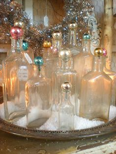 Pretty glass bottles with vintage ornaments
