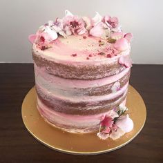 Vanilla semi naked pink ombré cake with meringues, flowers and freeze dried raspberries ~ we ❤ this! moncheribridals.com