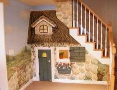 Under stairs play house.
