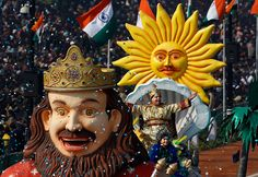India celebrates Republic Day - in pictures   Performers wave to the crowd from the float of the Indian state of Goa, at Rajpath, New Delhi  Kevin Frayer/AP