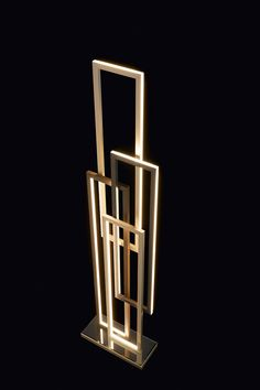 Edge floor lamp by Oasis, design by Massimiliano Raggi. LED lights diffused by a structure of aluminum, bronze and antiqued gold.