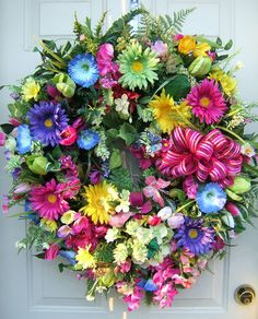 XL Spring wreath, Fiesta wreath,Easter wreath, beautiful bright floral wreath,  Door wreath, 31 by 27 by 8, Colorful wreath, XL and full. $139.95, via Etsy.