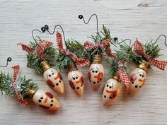 Size: Bulb is 3 long Hand painted Snowman on Vintage Glass Christmas Light Bulb WHITE. You will receive one ornament, not a set. Vintage glass light bulbs are painted white, the snowman face is then painted, antiqued, sealed and wired. The ornament is finished with homespun, greens and