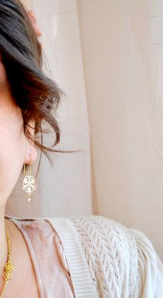Very delicate earrings with filigree and tiny   pearls