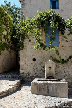 Vaison la Romaine in France. Note how this stone was cut at angle to match the sloping street. Iron bars are meant to hold buckets for filling water Vaison La Romaine, Ville France, French Architecture, Provence France, Garden Fountains, French Countryside, South Of France, Water Features, Beautiful Places