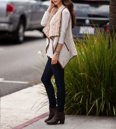Cozy faux sherpa detail adorns this soft wool blend vest. Features an open front + collar, two functional side pockets, and faux leather trim color: beige tone