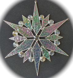 stained glass snowflake suncatcher  (design 10B) by bitsandglassart on Etsy https://www.etsy.com/listing/117086309/stained-glass-snowflake-suncatcher