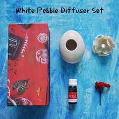 Aromatize your space with this lovely Pebble Diffuser Set !