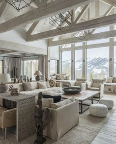Like the color of the beam Neutral Rustic Interiors. Neutral rustic living room with vaulted ceiling and exposed whitewashed beams and trusses and floor to ceiling win. Coastal Living Rooms, Home And Living, Living Spaces, Cozy Living, Small Living, Modern Living, Neutral Living Rooms, Big Living Rooms, Cottage Living