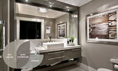 An industrial bathroom with white honed granite countertops, gray walls, a floating vanity and a porcelain square bowl sink. We especially love the addition of that framed artwork, as it adds a lot of warmth to the cold, modern design. Armoire Rose, Floating Vanity, Diy Bathroom Remodel, Bathroom Ideas, Bathroom Furniture, Amazing Bathrooms, Modern Bathroom, Industrial Bathroom, Sweet Home
