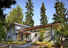 This Pacific Northwest House Is Located On A Wooded Waterfront Property