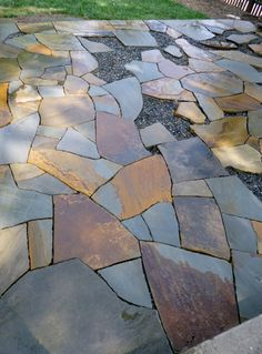 flagstone patio in process near downtown Asheville - there's a hidden fireplace pit under one of the flagstones. Brilliant!