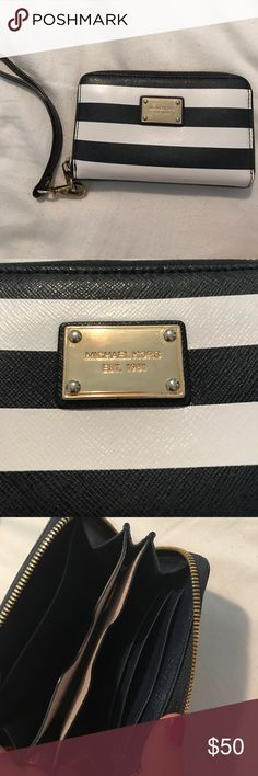 Michael Kors wristlet Navy and white striped Michael Kors wristlet. Only used once. Michael Kors Bags Clutches & Wristlets
