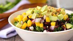 Avocado, black bean and mango salad on wilted kale