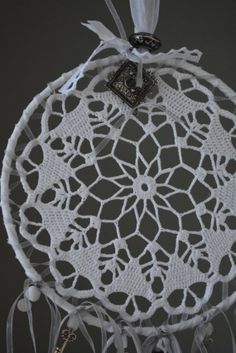 A vintage lace doily dream catcher in white and grey  shades---A vintage elegant touch or an special present