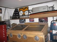 Sandblasting Cabinet - Homemade sandblasting cabinet featuring a dust fan to minimize dust. Constructed from plywood, lumber, plastic, and steel. Sandblasting Cabinet, Icebox Cake, Diy Cabinets, Plywood, Minimalism, Construction, Homemade, Tools, Shop Ideas