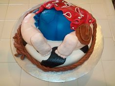 Cowboy baby bum cake for a baby shower. Wow totally amazing.
