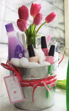 Cute gift basket Idea for teen (( maybe an ice bucket for Mother's day)) too awesome...oooh or HOT RED nail polish for birthday 'girls!' the FLOWERS ARE A MUST! with this gift!