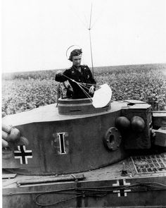 A unit commander with his Tiger 1 tank at Kursk, 1943