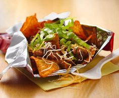 Need a fun snack or light meal idea? Enjoy these 5-minute Mexican-style microwaved ground beef and cheese blend topped nacho-flavored tortilla chips.