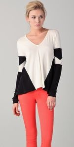 geometric top and red pants