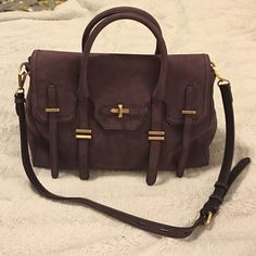 """SALE NWT Rebecca Minkoff Aubergine Jules Satchel My lowest price!! The perfect polished work bag! Aubergine (dusty purple) suede 14.5""""W x 10"""" H x 6"""" D.  3.5"""" handle drop. 17"""" detachable shoulder strap, adjustable. Magnetic button closure. Gold hardware. 1 exterior pocket, 2 interior slip pockets, 1 zip pocket.  New with tag. Rebecca Minkoff Bags Satchels"""