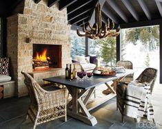 Love that fireplace Decorating Ideas for Rustic Lodge Homes & Photos of a Mountain Home in Idaho - ELLE DECOR Cozy Fireplace, Fireplace Design, Limestone Fireplace, Fireplace Mantels, Fireplace Seating, Modern Fireplace, Elle Decor, Outdoor Rooms, Outdoor Dining