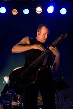 Trey Gunn, formerly of King Crimson, playing two-handed Warr guitar.  The man is a beast on this instrument.  Must be a bitch to play or more bass players would use them.