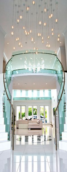U-shaped double staircase, nice white finish, and glass railing match well together. The hanging lights and design amidst the tiling give off very nice feeling to the home. easy to clean simple elegant glamourous white double staircase Double Staircase, Grand Staircase, Staircase Design, Luxury Staircase, Custom Home Designs, Custom Homes, Stairway Lighting, Interior Architecture, Interior Design