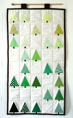 pattern: mini tree quilt — Check out the wooden knitting needle for a hanger
