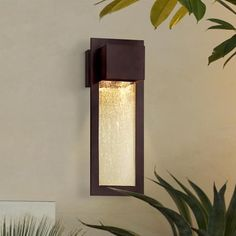 This simple modern outdoor wall light features a flat panel of clear seeded glass in front of two halogen bulbs. A metal trim frame in warm Alder bronze finish enhances the inviting geometric design. A beautiful addition to your home from Minka lighting. Outdoor Wall Light Fixtures, Modern Outdoor Wall Lighting, Exterior Light Fixtures, Outdoor Wall Sconce, Exterior Lighting, Outdoor Walls, Exterior House Lights, Wall Lights, Ceiling Lights