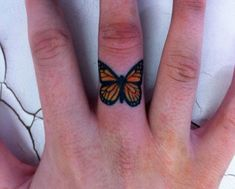 Butterfly finger tattoo - 55+ Cute Finger Tattoos