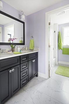 This new second-floor bath serves two new bedrooms. A door between the double-sink vanity and the shower/toilet area, which has its own sink, makes it easier for two to share the space.