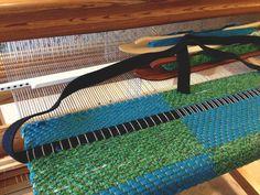 Weaving bag handles into the rag rug bag.