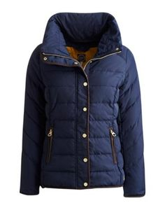 Joules Womens Padded Jacket, Marine Navy.                     Beat the chill in this warm padded jacket that's the perfect companion for blustery days.  A concealed hood is hidden inside a neck hugging collar that's just right for keeping out any sudden draughts. A suede-feel trim and dropped hem only add to this jacket's appeal.