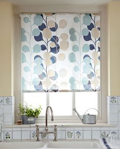 Ready-made roller blinds don't equal dull designs. It's possible to get some great, on-trend patterns to give your room a boost. Many can be cut to size - as with this version - so you can get a stylish window treatment at an affordable price.