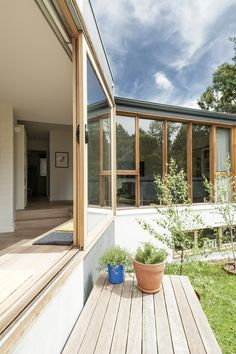 Doncaster House: a renovation of a brick and weatherboard dwelling on a large triangular site Pergola Pictures, Suburban House, Melbourne House, House Extensions, Beautiful Living Rooms, Pergola Designs, Sliding Glass Door, Glass Doors, Glass House