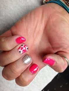 Neon pink with silver glitter and white flower design on accent nails  Oasis Salon and Spa Mill Hall Pa (570)726-6565