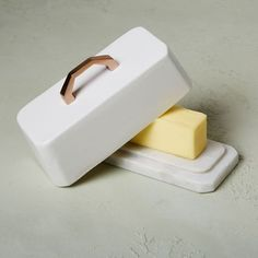 Copper + Enamel Butter Dish | Elevate your everyday with our Copper + Enamel Butter Dish. Its mix of materials creates a stylish and functional tabletop accent for any meal.
