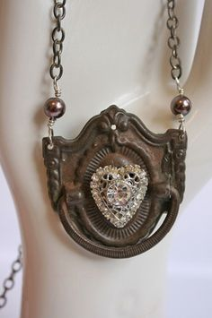 suzanne duda..how awesome! old door knocker with an antique brooch!!