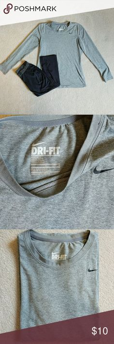 """Nike Dri-Fit Long Sleeve Womens Shirt Color: heathered grey Fit: """"regular fit"""" Type: Nike Dri-fit, long sleeve  Condition: pre-loved, no stains/pilling/holes Material: 100% polyester Always feel free to make an offer! I will also discount bundles of 2+ items 😁 Nike Tops Tees - Long Sleeve"""