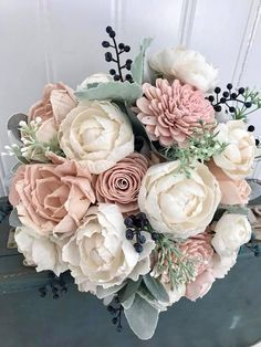 Blush and ivory peony and rose wedding bouquet, Sola wood flowers, eco flowers ***12 bouquet READY TO SHIP** All other sizes are maade to order. Unique wedding bouquet full of natural sola wood flowers. The wooden flowers are hand dyed in shades of pale blush pinks. Navy blue berries, #weddingbouquets