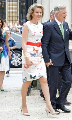 Keeping cool in the heat, Queen Mathilde of Belgium wore a short-sleeved butterfly print dress to the 'Fete au parc' celebrations on the Belgian National Day.