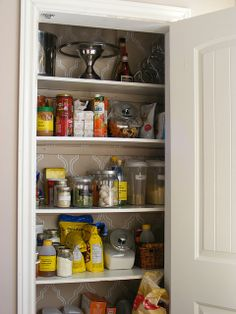 pantry in the small space between studs. small house, small home, tiny house, tiny home, small spaces, small space living, space-saving, compact, kitchen, storage