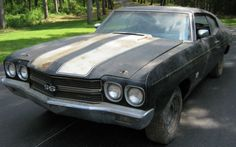 This 1970 Chevelle SS has been parked in a barn for the past 20 years. Black, 396, 4-speed, bench... Does it get any better than this?